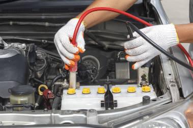 mechanic-checking-car-battery