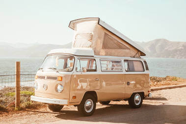 camper-parked-on-coastal-road